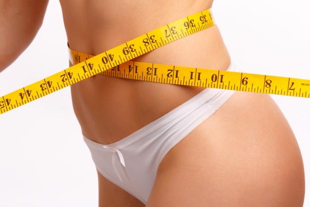 da-cintura-das-mulheres-com-uma-fita-metrica_1208-98